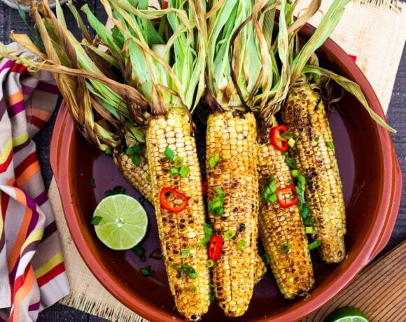 This Indian Masala Street Corn hails from the streets of Bombay. It's lathered with ghee and garam masala spice- a simple easy summer side dish to add to your next Indian feast!#grilledcorn #masalacorn #indiancorn