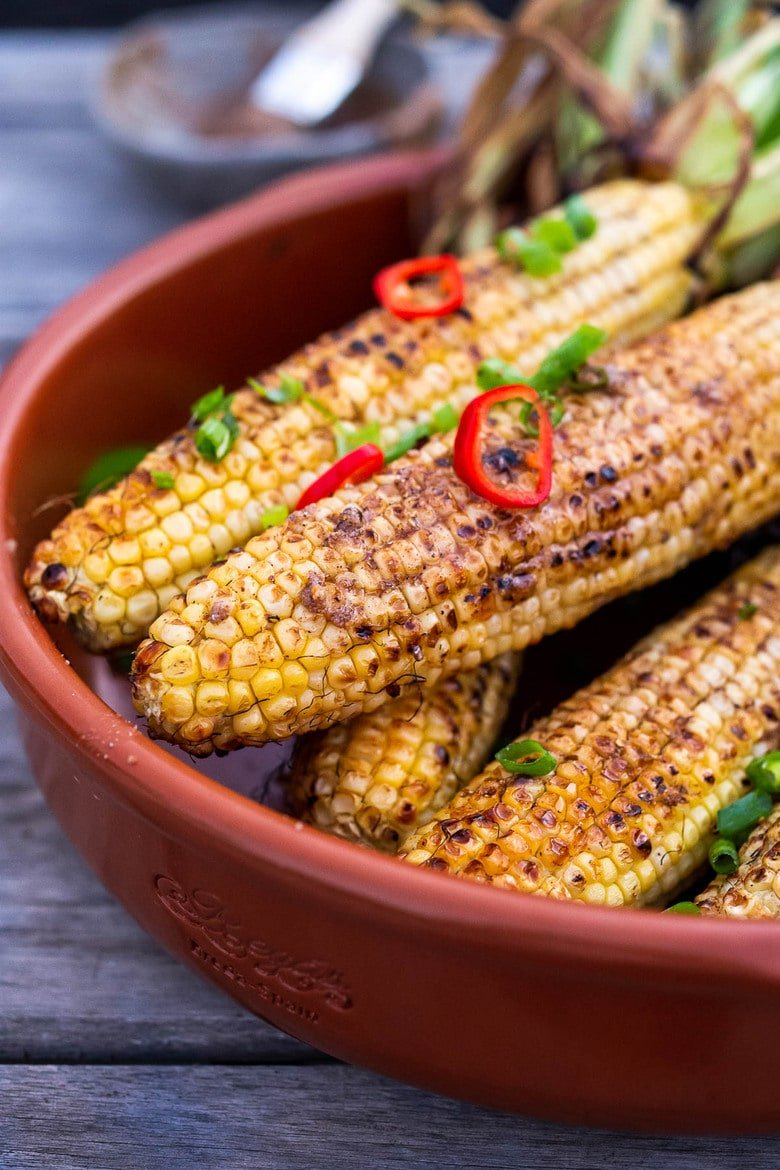 This Masala Street Corn hails from India and is grilled and seasoned with ghee and garam masala spice! A simple easy summer side dish to add to your next Indian feast! #grilledcorn #masalacorn #indiancorn