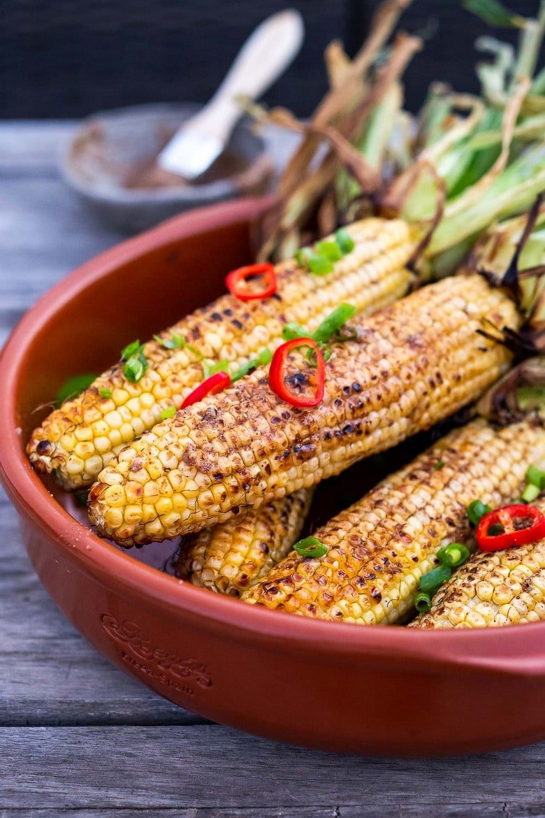This Masala Street Corn hails from India and is grilled and seasoned with ghee and garam masala spice! A simple easy summer side dish to add to your next Indian feast!#grilledcorn #masalacorn #indiancorn