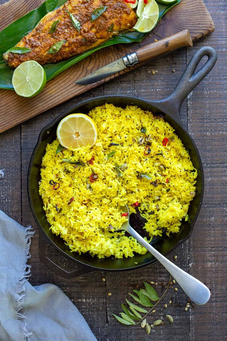 Kerala-Style Fish served with Lemon Rice. Curry leaves and Tamarind give this Indian Recipe its unique flavor. #kerala #keralafish #whitefish #indianrecipes