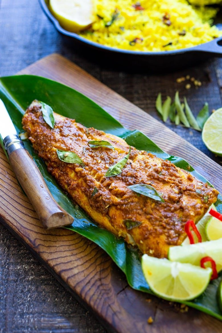 Here's a simple yet super flavorful recipe for Kerala-Style Fish, made with a flavorful paste that is either grilled or roasted in the oven. Curry leaves and Tamarind give this Indian Recipe its unique flavor. #kerala #keralafish #whitefish #indianrecipes