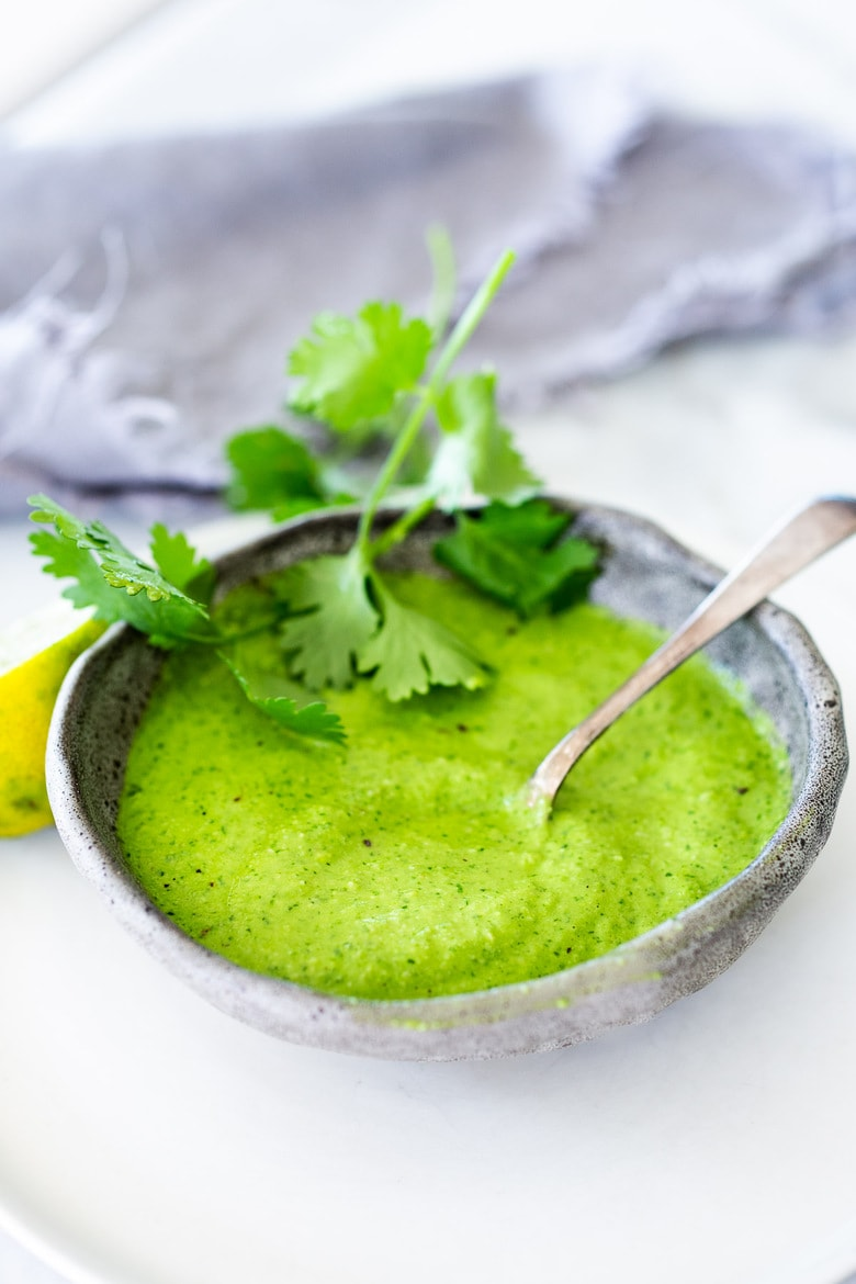 Peruvian Green Sauce (Aji Verde)! This recipe is vegan-adaptable, so you can skip the mayo if you prefer. A spicy, tangy flavorful condiment that is delicious on so many things! #ajiverde #peruviangreensauce #vegan