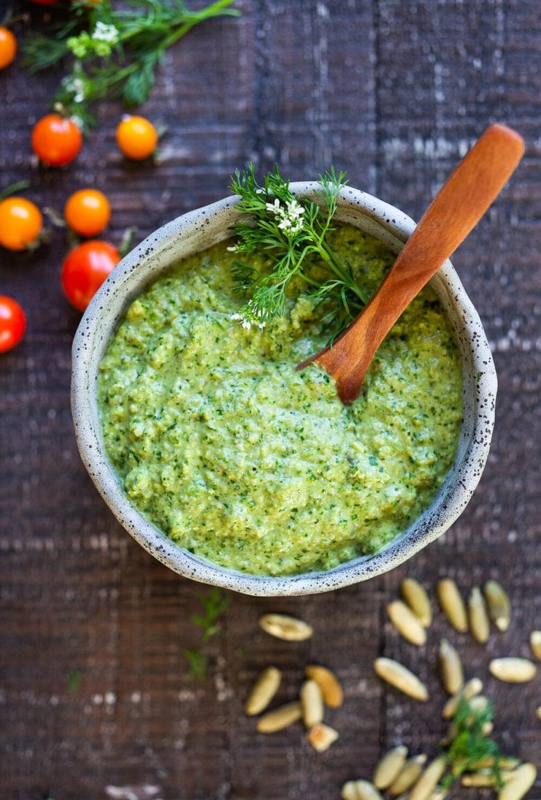 A flavorful recipe for Poblano Pumpkin Seed Sauce made with roasted poblano peppers and pumpkin seeds- a tasty addition to tacos, enchiladas, or burrito bowls! #poblanosalsa #pepitasalsa #pepitasauce