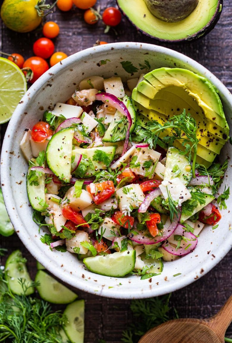 This vegan, plant-based Ceviche will transport you to Mexico. Made with hearts of palm and avocado, this easy recipe can be served on tostadas, with chips or in lettuce cups! #veganceviche #heartsofpalm #veganmexican #ceviche