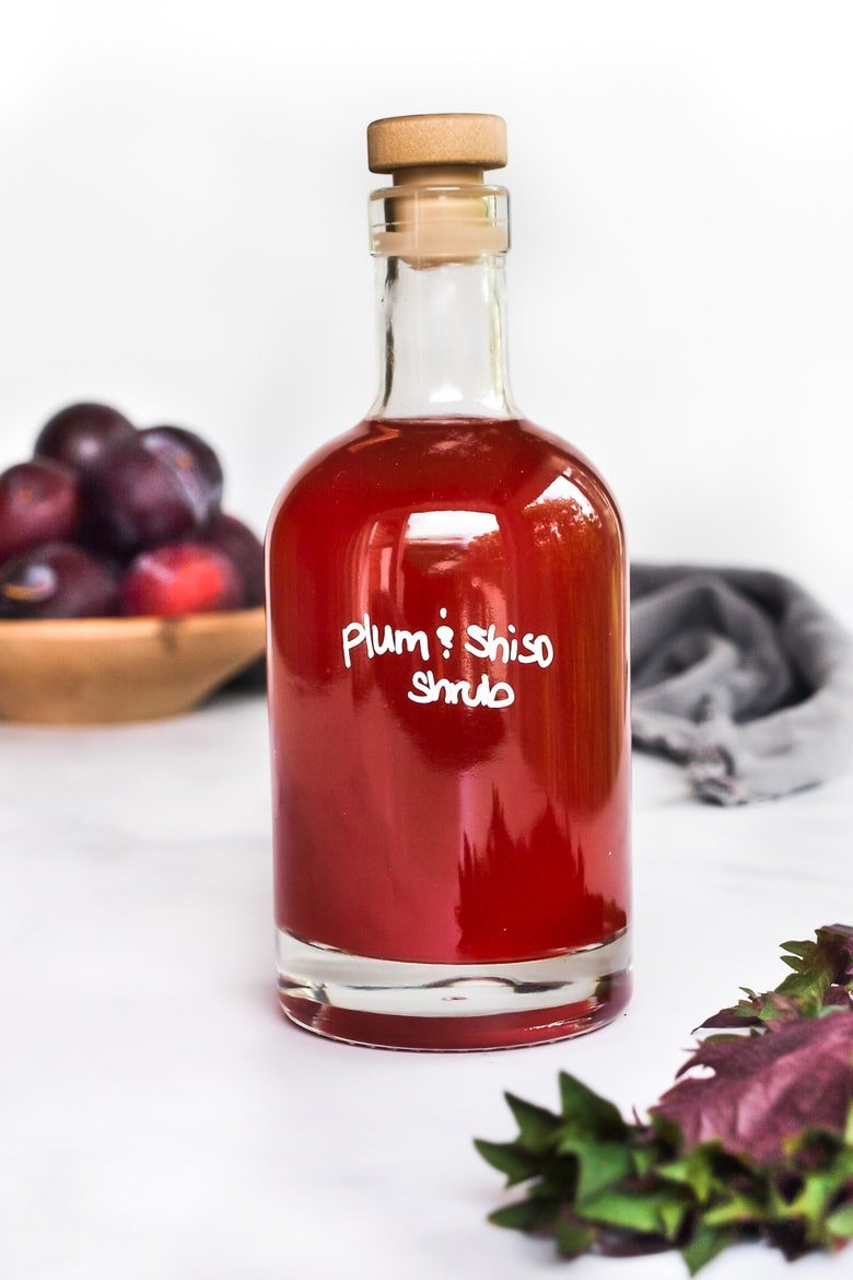 How to make a shrub, a flavorful, fruit-infused drinking vinegar used in cocktails, mocktails, vinaigrettes and sauces! This makes for a beautiful hostess gift!