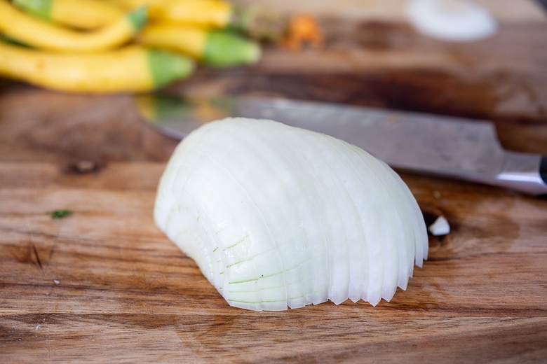 chopping onions for zucchini quesadillas