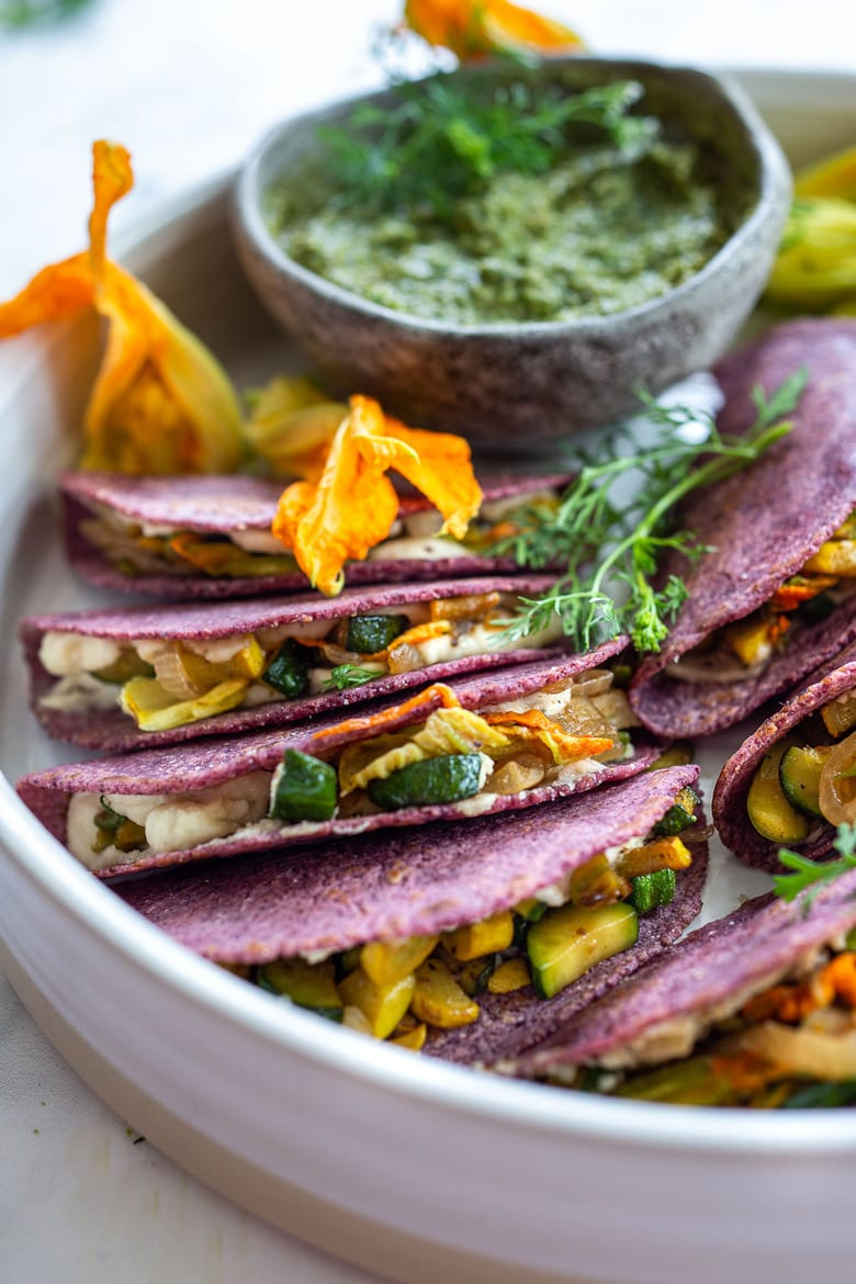 These flavorful Zucchini Quesadillas are made vegan with cashew cheese and served up with a flavorful Poblano Salsa. #quesadillas #vegan #plantbased #wfpb