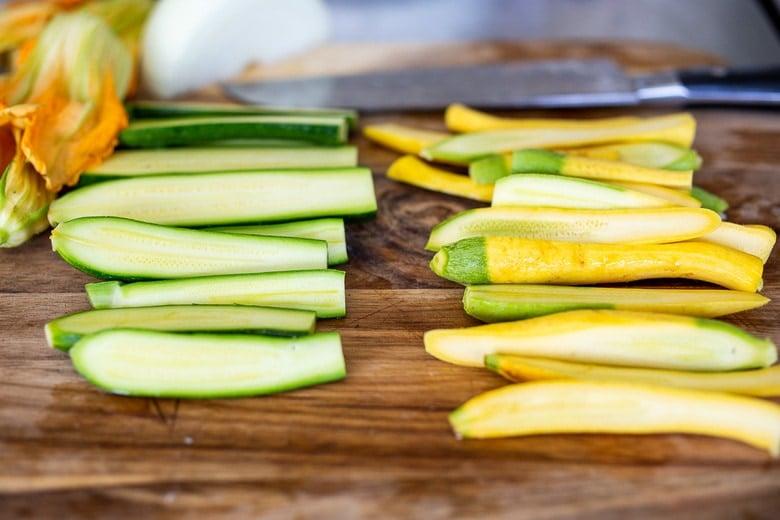 chopping zucchini for vegan quesadillas