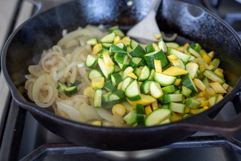 sauting onions and zucchini for vegan quesadillas
