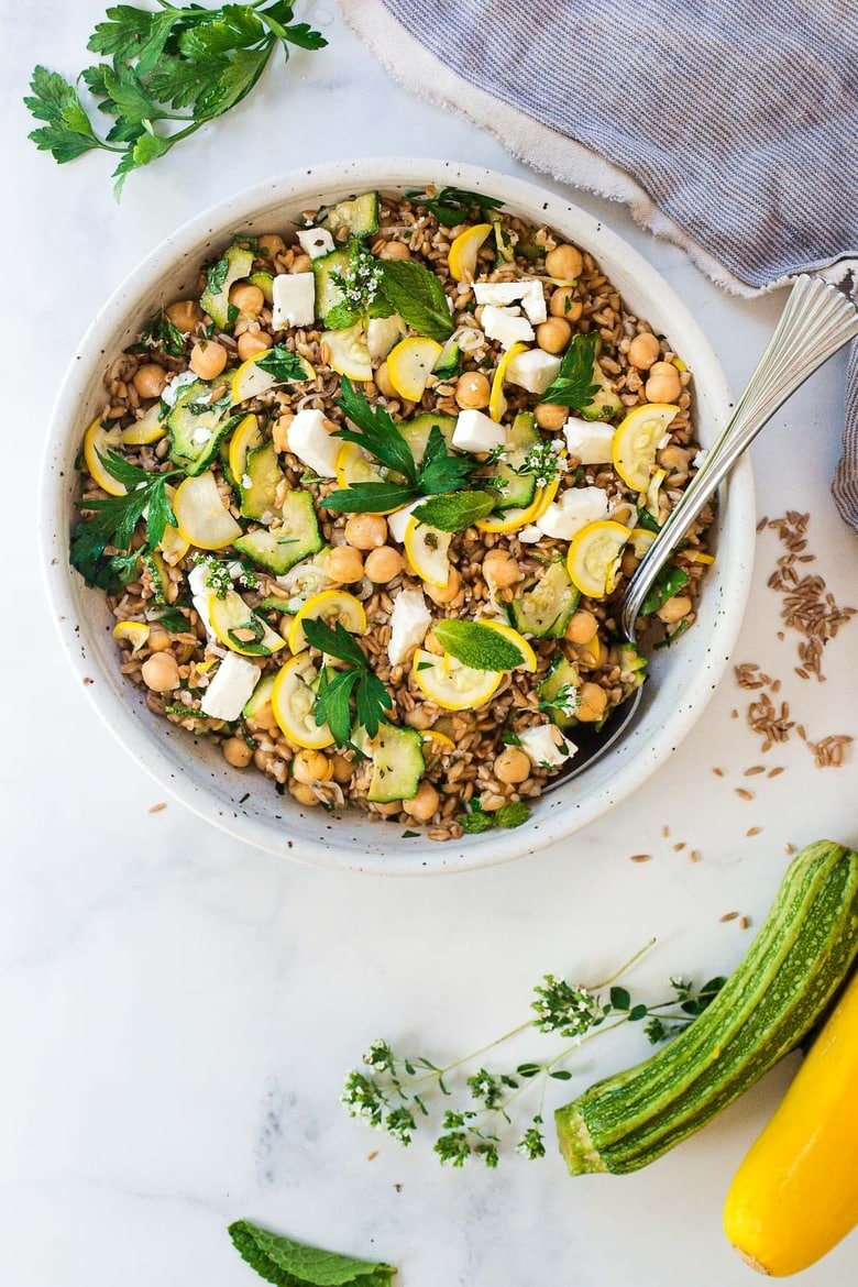 Mediterranean Farro Salad with Marinated Zucchini & Chickpeas, fresh herbs and optional feta, tossed a simple lemony dressing. #farrosalad #vegansalad #zucchinirecipes #chickpeasalad
