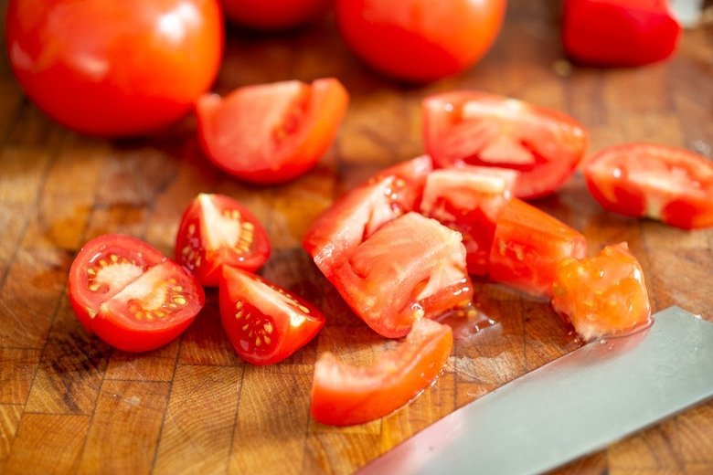 chopping the tomatoes for tomato soup