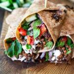 Turkish Lamb Wrap with ground lamb, sumac, mint, cucumbers, tomatoes and yogurt.