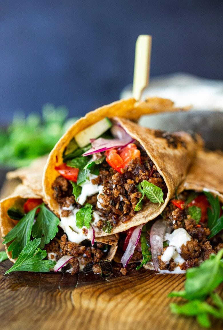 Fast and flavorful, Turkish Lamb Wraps are made with savory ground lamb seasoned with flavorful Turkish spices, wrapped up in a tortilla with labneh, cucumbers, tomatoes, mint, parsley and peppery watercress. A simple weeknight dinner that can be made in under 30 minutes.#lamb #americanlamb #lambwrap #turkishwrap