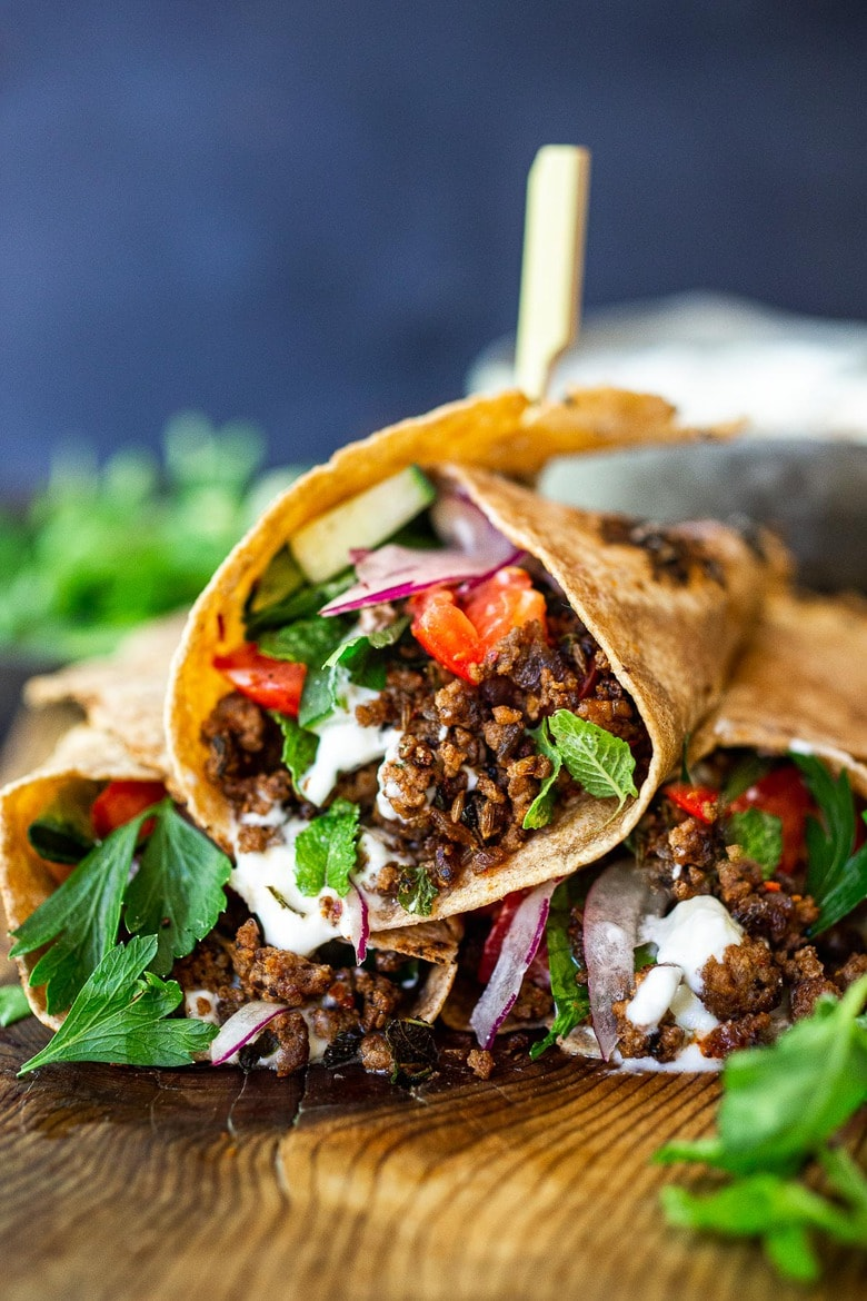 Fast and flavorful, Turkish Lamb Wraps are made with savory ground lamb seasoned with flavorful Turkish spices, wrapped up in a tortilla with labneh, cucumbers, tomatoes, mint, parsley and peppery watercress. A simple weeknight dinner that can be made in under 30 minutes. #lamb #americanlamb #lambwrap #turkishwrap