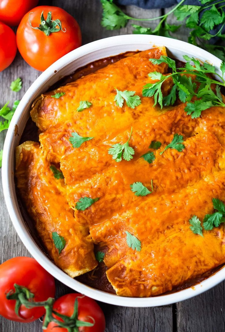 Chicken Enchiladas made with 5-Minute Enchilada Sauce (easy red sauce) and shredded chicken. A delicious comfort food meal the whole family will love. #enchiladas #chickenenchiladas