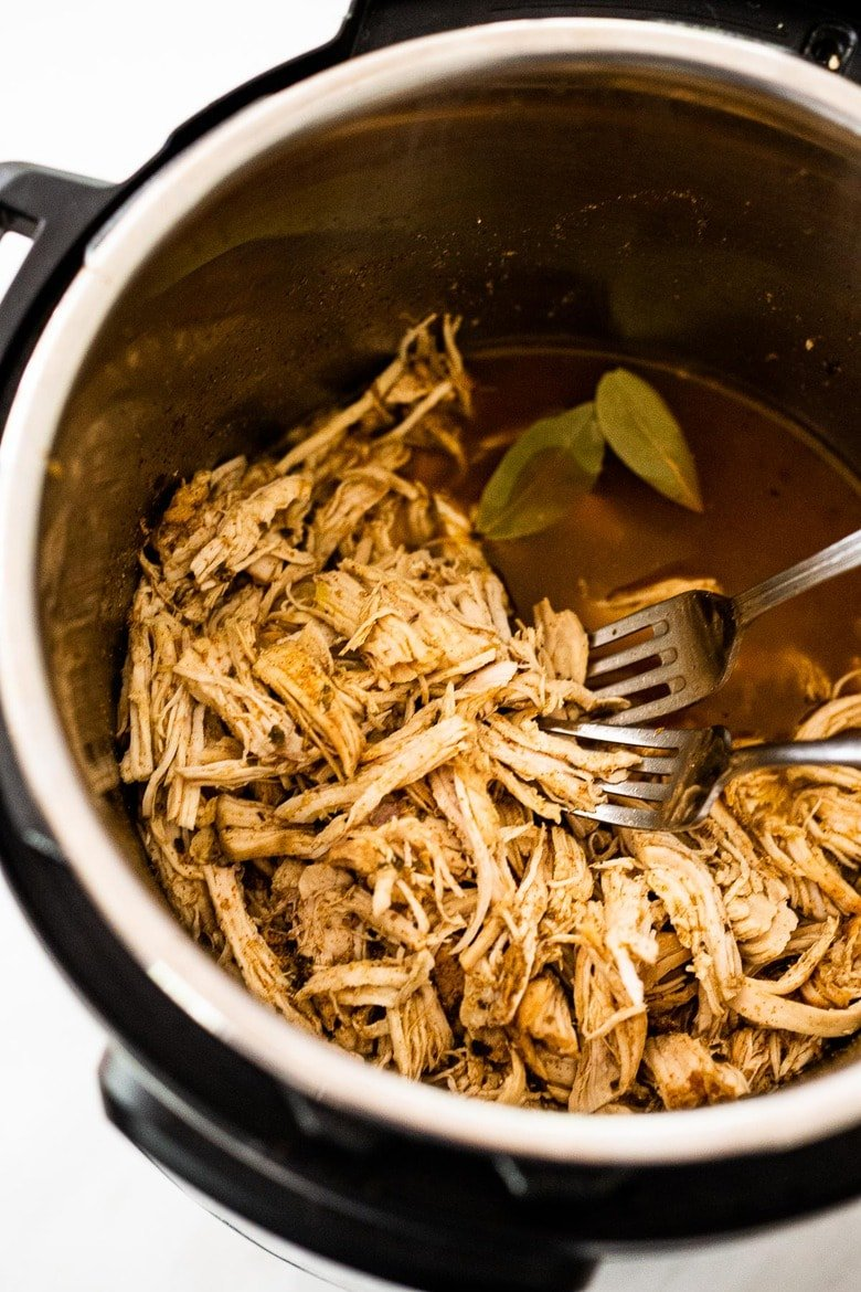 A simple easy recipe for Shredded chicken that can be made in an Instant Pot, Slow Cooker or on the Stovetop. Use breasts or thighs, fresh or frozen, great for meal prep and busy weeknight dinners. Keeps for 5 days in the fridge, or freeze! #shreddedchicken