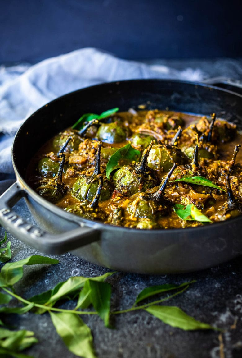 A flavorful recipe for Brinjal Curry (Indian Eggplant) gently simmered in a fragrant Masala Sauce. Serve with Indian-style Basmati Rice and naan bread for a delicious vegetarian or vegan meal. #brinjal #curryeggplant #indianeggplant #brinjalcurry