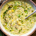Cozy up with a bowl of this Coconut Corn Chowder with Leeks- a simple, comforting meal that can be made in under 30 minutes. Vegan and Gluten-free! #cornchowder #vegancornchowder #vegansoup