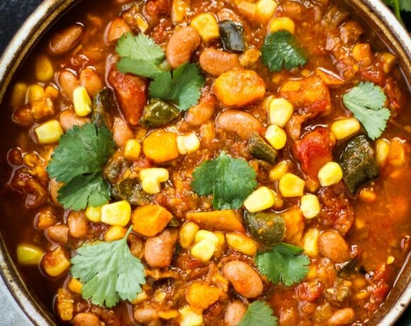 Instant Pot Pinto Bean Stew using dry beans with corn, yams, and poblanos. A vegan-adaptable soup that only takes 15 minutes of hands-on time. #instantpotrecipe, #vegansoup #veganstew #pintobeanstew