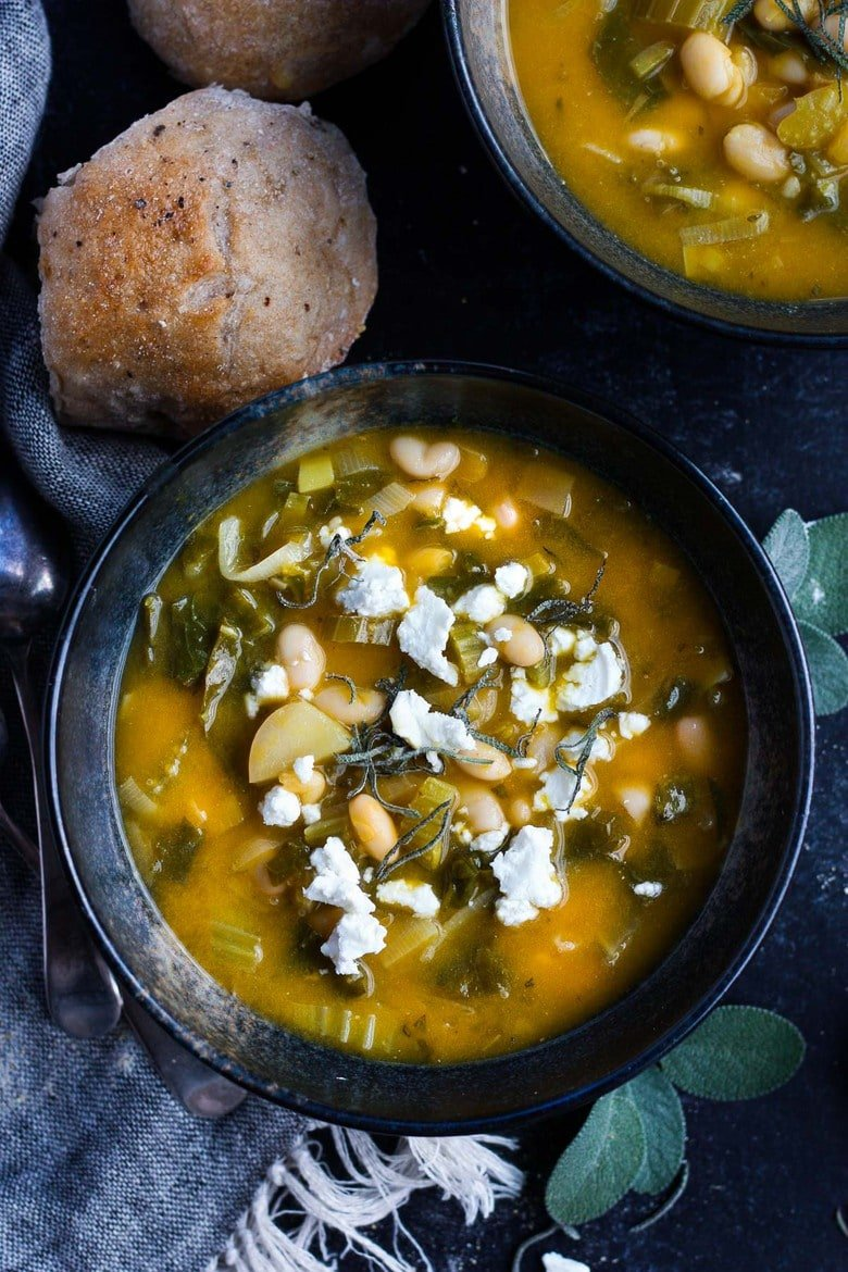 A simple recipe for Pumpkin Soup With Leeks, Kale, white beans and Sage. Vegan, flavorful, and EASY- can be made in 30 minutes! #pumkinsoup #vegansoup