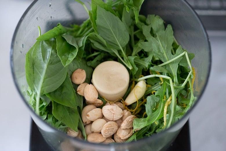 how to make arugula basil pesto- using a food processor. Vegan.