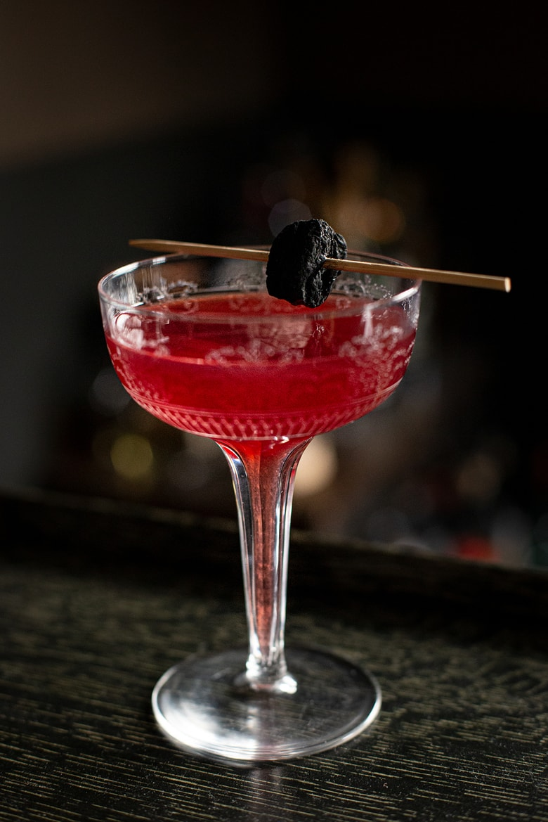 "A festive holiday cocktail made with assertive rye whiskey, enlivened with tart cranberry & lemon, the whole softened by 2 festive liqueurs; garnished with a bit of holiday fruit, or (depending on how you've been this year) - a lump of ""coal""."