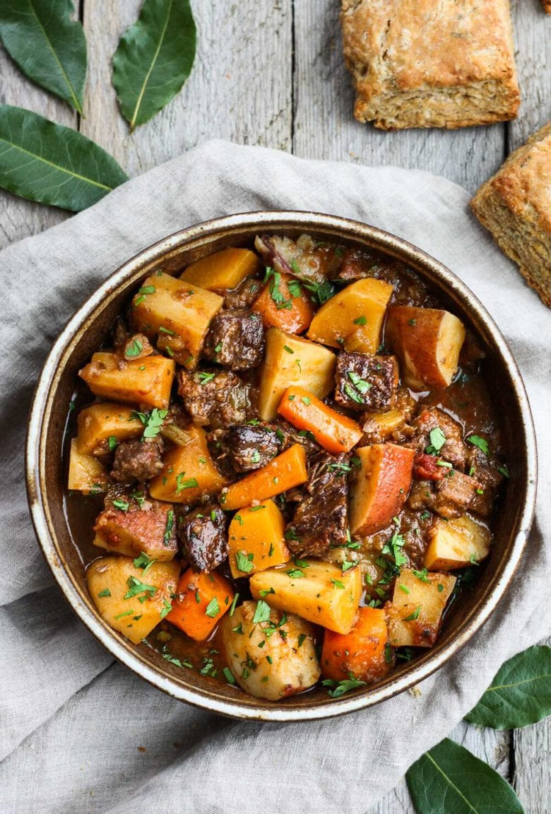 Get warm and cozy with this Instant Pot Beef Stew with Root Veggies- a hearty, comforting one-pot meal made in the pressure cooker, that is keto friendly, easy to make and full of depth and flavor. #beefstew #instantpotbeefstew #instantpot #bestbeefstew