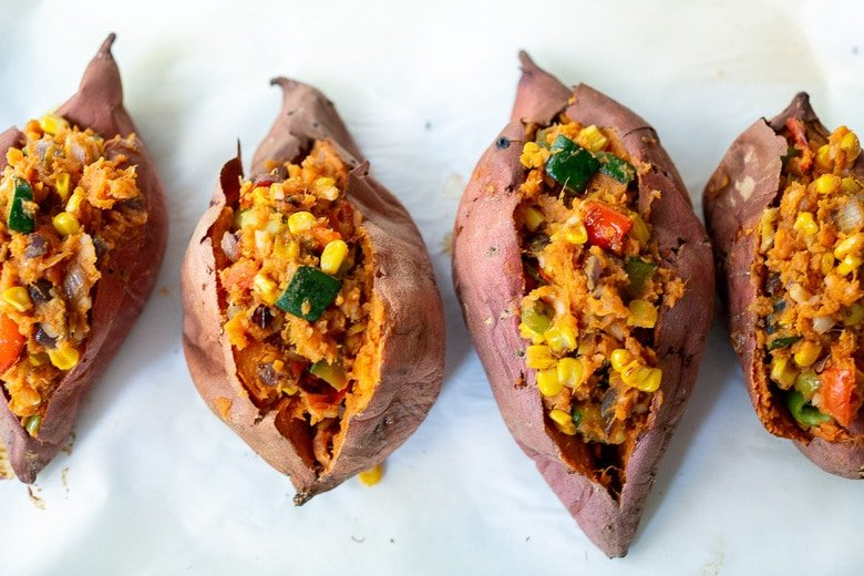These Oaxacan-Style Baked Sweet Potatoes are loaded up with healthy veggies and infused with Oaxacan flavors, served up over optional 5-Minute Mole Sauce. Healthy, flavorful and perfect for Sunday meal prep to reheat during the busy week. Vegan-adaptable! Gluten-free.