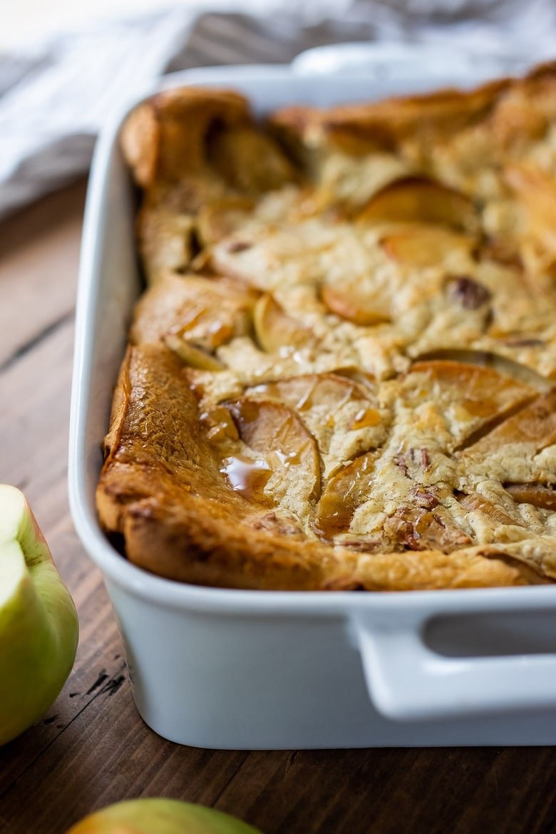 A simple recipe for Pannekoeken, a baked apple pancake hailing from the Netherlands, this version is infused with cardamom and nutmeg and puffs up dramatically in the oven. A delicious weekend breakfast or brunch.#applepancake
