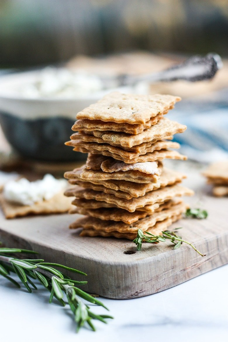 How to make homemade sourdough crackers from sourdough discard or starter. A quick, easy and adaptable recipe. These crackers are crisp, tangy and incredibly addicting!
