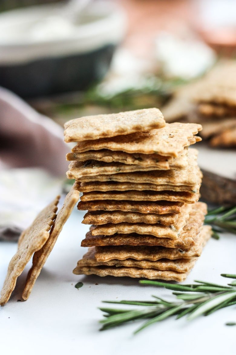 How to make homemade crackers from sourdough discard or starter. A quick, easy and adaptable recipe. These crackers are crisp, tangy and incredibly addicting! #sourdough #discard #crackers #crackersrecipe