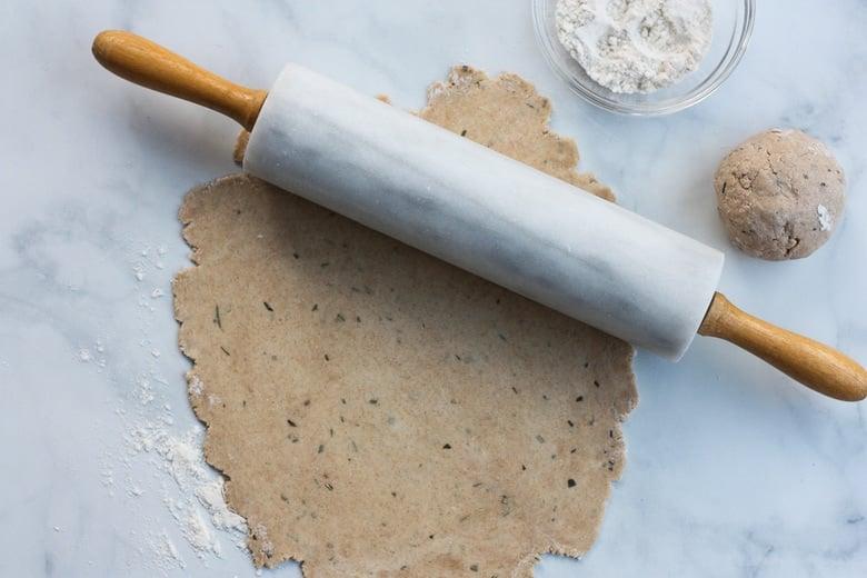 rolling out sourdough discard dough