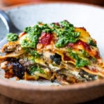 An EASY Eggplant Lasagna made with no-boil noodles and topped with Arugula Pesto. A delicious, healthy vegetarian dinner recipe that is comforting and nourishing.