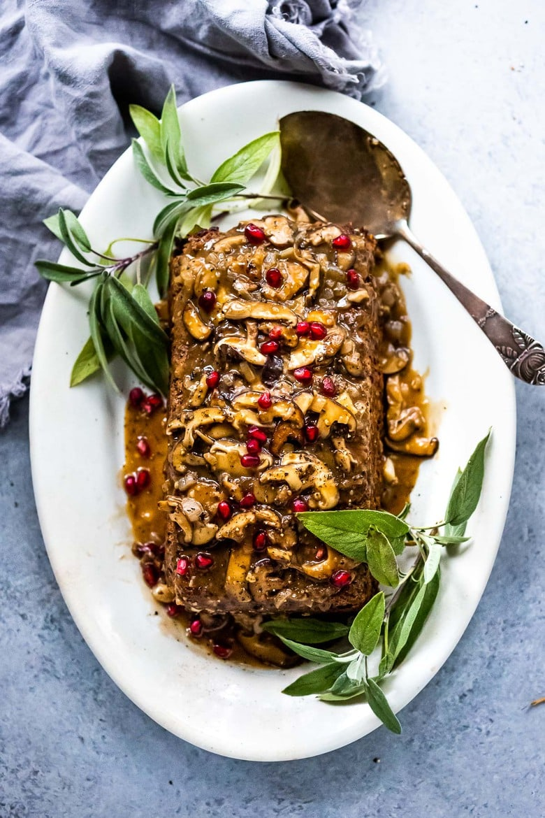 A savory vegetarian main dish, this Sagey Mushroom Walnut Roast is a beautiful addition to your holiday table. #nutloaf #mushroomloaf