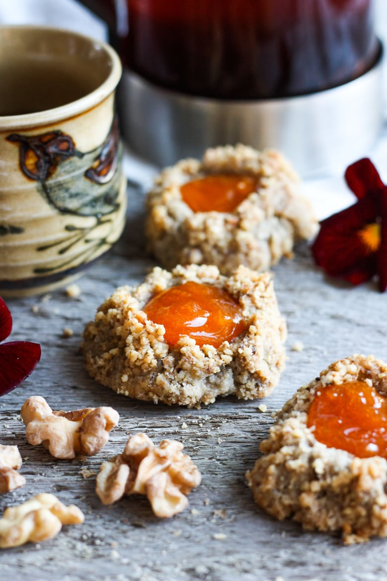 Thumbprint Cookies are a perfect treat for the holidays. A melt in your mouth rustic thumbprint cookie with rye, toasty walnuts, cardamom and tangy apricot jam- a perfectbalance of flavors, decadent and lightly sweet with a satisfying crunch. #thumbprintcookies