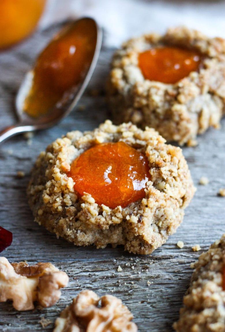 Thumbprint Cookies are a perfect treat for the holidays.  A melt in your mouth rustic thumbprint cookie with rye, toasty walnuts, cardamom and tangy apricot jam-  a perfect balance of flavors, decadent and lightly sweet with a satisfying crunch. #thumbprintcookies