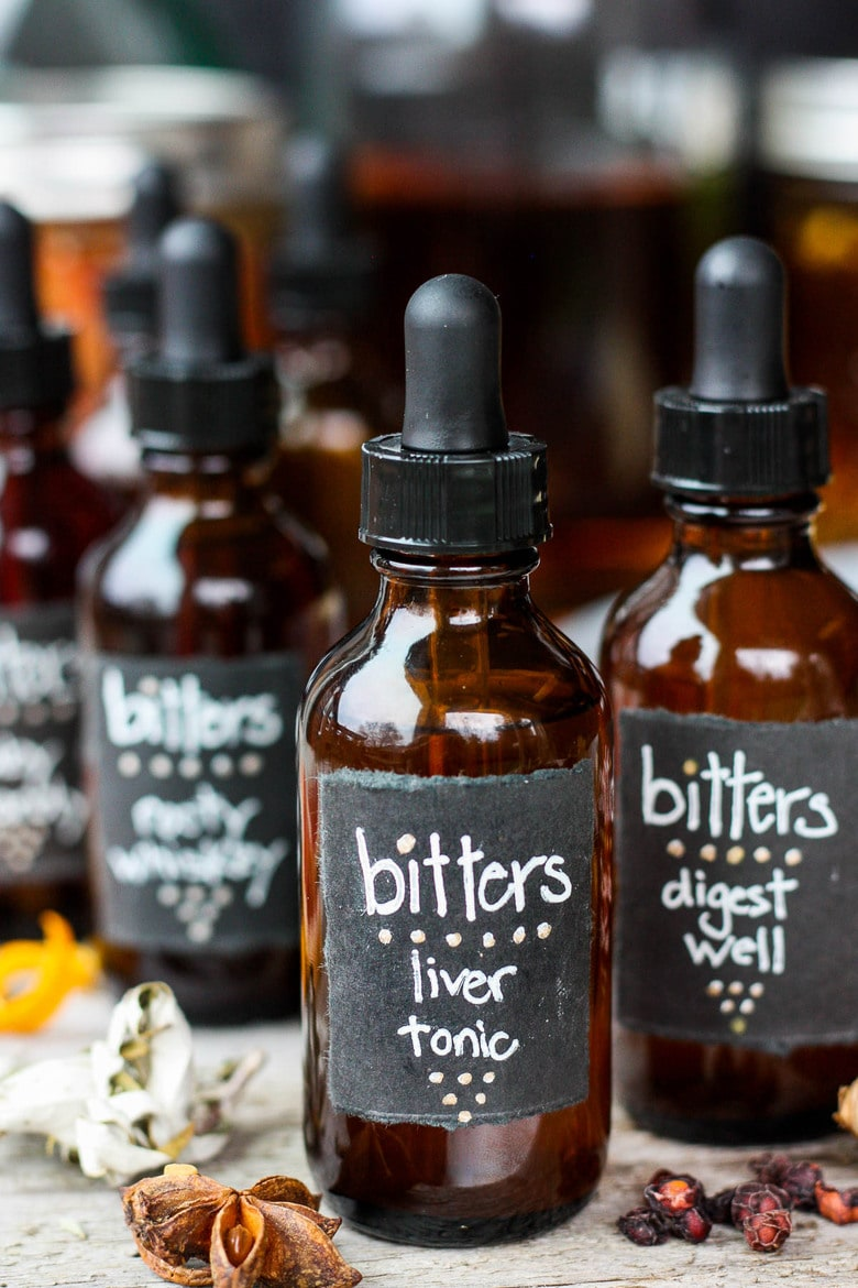 Learn how easy it is to make your own homemade bitters! An important health tonic that can boost digestion, balance liver health and so much more. Bitters add beautiful interest and depth to drinks and cocktails. A fun and easy project that takes very little hands-on time! Perfect for holiday gifts and stocking stuffers.