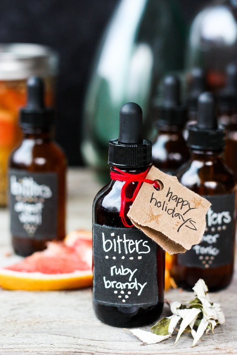 How to make Digestive bitters and Liver Tonic. An important health tonic that can boost digestion, balance liver health and so much more. Bitters add beautiful interest and depth to drinks and cocktails. A fun and easy project that takes very little hands-on time! Perfect for holiday gifts and stocking stuffers.