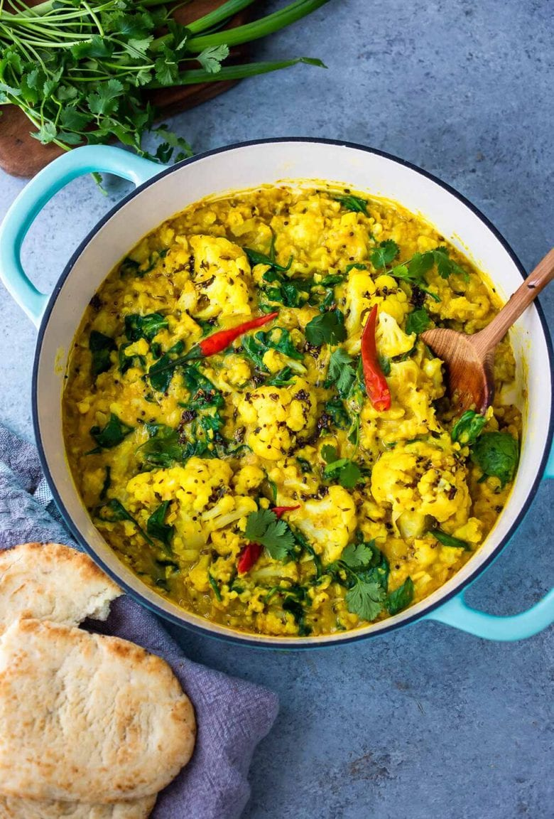 Cauliflower Dal with Coconut and Spinach made with split red lentils and fragrant Indian spices. A healthy comforting, plant-based dinner recipe. Vegan-adaptable. #dal #cauliflower #dalrecipe #lentils
