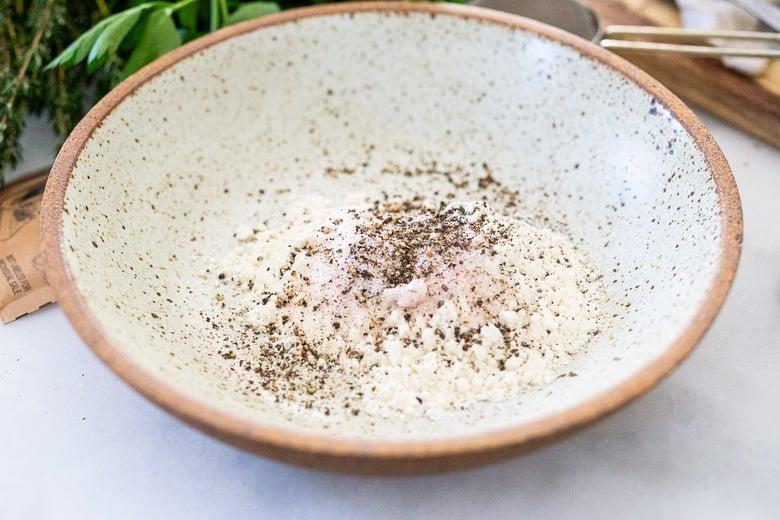 bowl of flour, salt, pepper