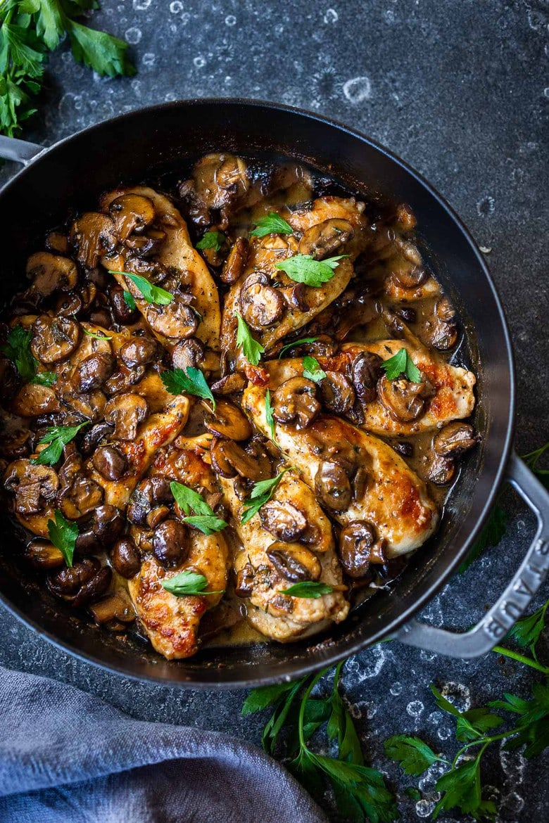 A classic recipe for Chicken Marsala (w/ double the mushrooms!) bathed in a creamy flavorful Marsala Sauce. An Italian-inspired dinner, perfect for weeknights or Sunday Supper! #chickenmarsala #chickenrecipes