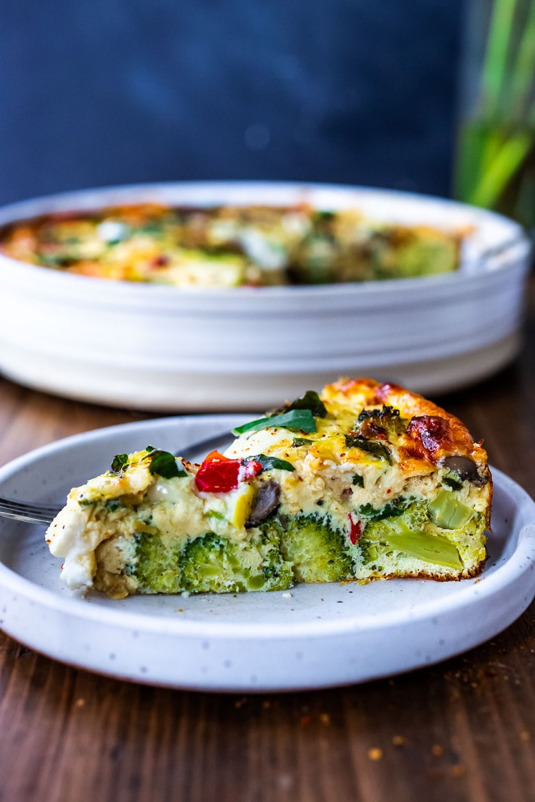 This delicious Baked Frittata is easy to make, full of healthy vegetables, and very versatile. It can be made ahead - perfect for a holiday breakfast or brunch, or serve it up for lunch or dinner -an easy, clean-out-the fridge kind of meal. This crustless quiche is Keto, Gluten-free and low-carb.#frittata #healthybreakfast