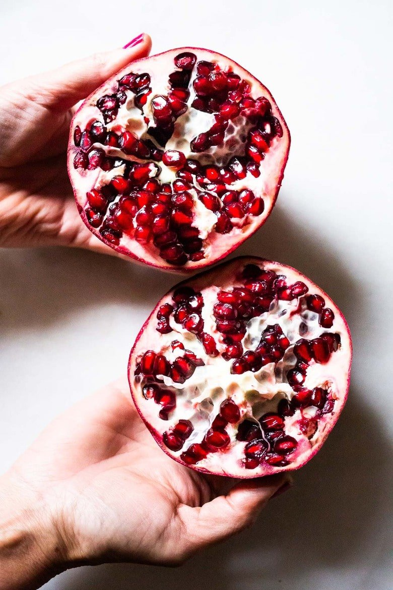 The EASIEST way to cut a pomegranate with a quick video tutorial. Once you try this method, for deseeding a pomegranate, you'll never go back! #pomegranate
