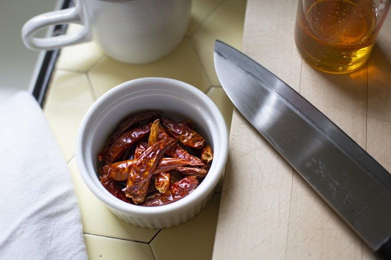 dried chilies in a rampkin