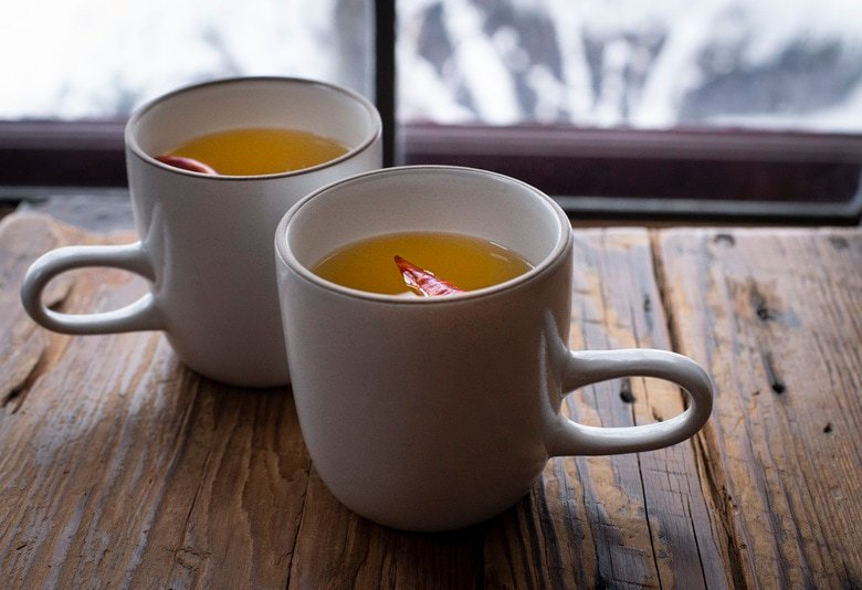How to make a Hot Toddy at home, that we think is better than most of the professional versions you're likely to encounter! This recipe uses mezcal, lime juice & honey - but you can easily swap those out for the traditional whiskey with lemon - or nearly any other base spirit, citrus & spice combination that suits your tastes. #hottoddy