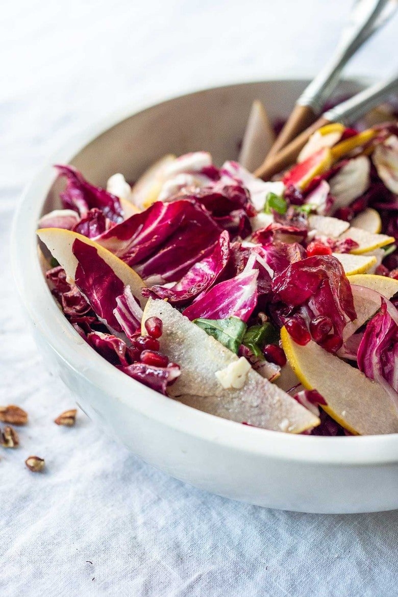 A simple, festive Radicchio Salad with Asian pears, walnuts, basil, shaved pecorino and pomegranate seeds in a simple vinaigrette dressing. Make ahead and toss before serving. #radicchio #radicchiosalad
