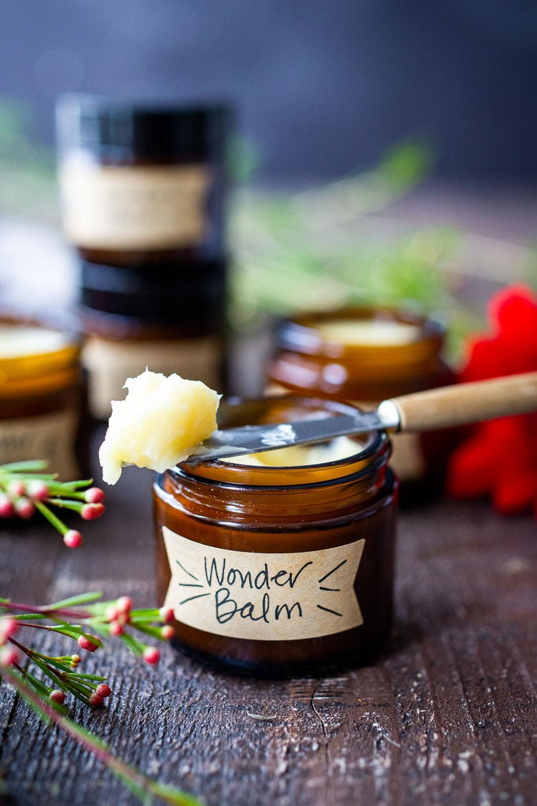 How to make a creamy Shea Butter Body Balm to sooth dry winter skin, tame locks, heal cracked lips, and moisturize dry hands and feet. Made with simple all natural ingredients, scented with your choice of essential oils. #balm #salve #bodybutter