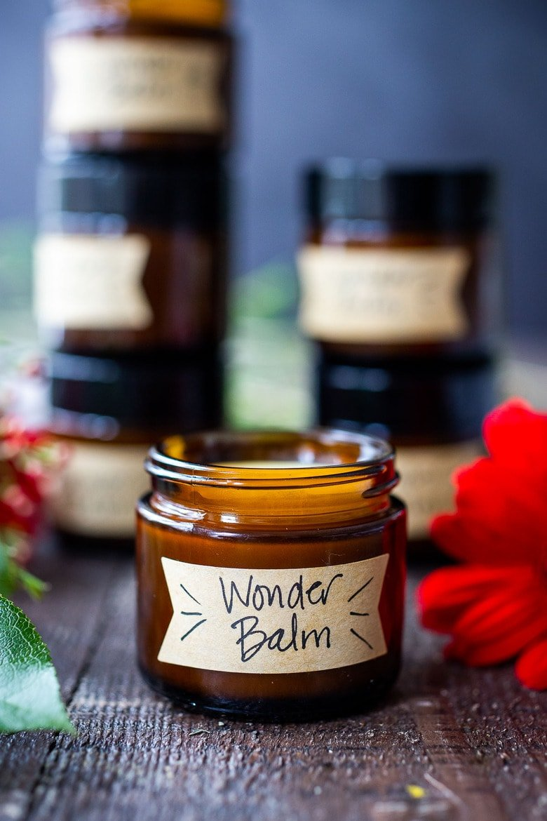 How to make a luscious, creamy Shea Butter Body Balm to soothe dry winter skin, tame locks, heal cracked lips, and moisturize dry hands and feet. Made with simple all-natural ingredients, scented with your choice of essential oils.