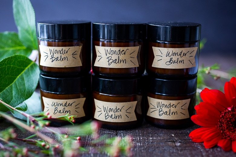 How to make a luscious, creamy Shea Butter Body Balm to sooth dry winter skin, tame locks, heal cracked lips, and moisturize dry hands and feet. Made with simple all natural ingredients, scented with your choice of essential oils. #balm #salve #bodybutter