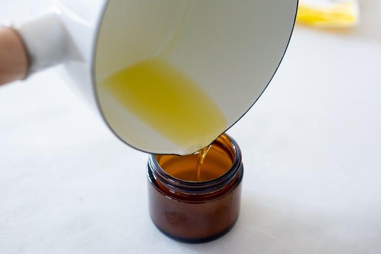 pour the shea body balm into jars